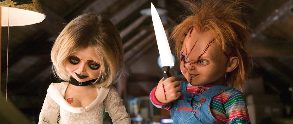 Film still showing Tiffany with Chucky holding a kitchen knife